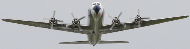 DC-7 Flying past